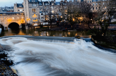 A long exposure of the River Avon near Pultaney Bridge in Bath, UK.