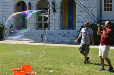Researchers from the Burton Lab test their giant soap bubble-making prowess.