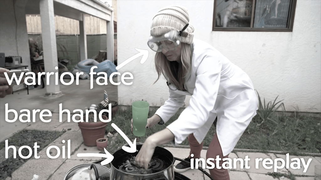The big moment: Dianna relies on the Leidenfrost effect to protect her as she dunks a hand in boiling hot oil.