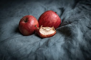 Three apples, one of them dry and creased.