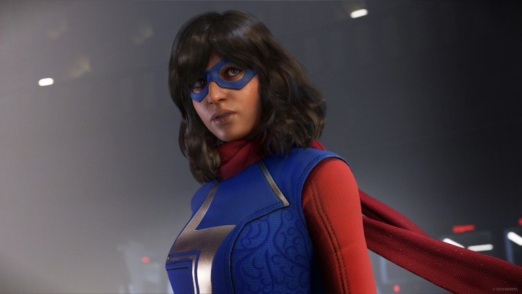 Upper body/face shot of Kamala Khan wearing her iconic superhero outfit (cape included) with wavy shoulder-length hair. international female characters video games