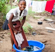 african girl washing clothes