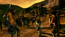 Fighting an array of zombies against a desert background in 'Resident Evil 5' for PC
