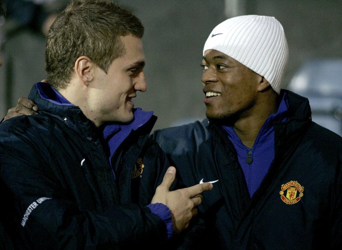 Manchester United's two new signings Nemanja Vidic, left, and Patrice Evra, right, before their English League Cup semi-final 1st leg soccer match against Blackburn Rovers at Ewood Park, Blackburn, England, Wednesday Jan. 11, 2006. (AP Photo/Dave Thompson)