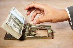 Value Trap Mouse Trap Hand With Money Getty