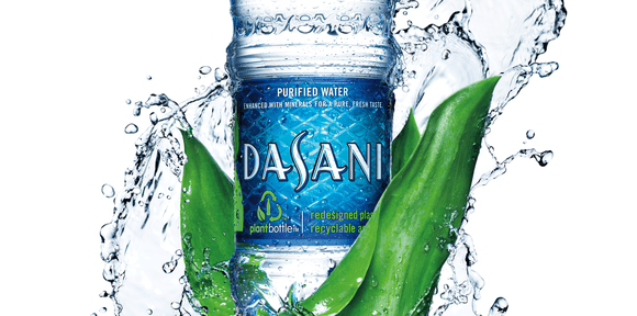 """A bottle of Dasani water, with the """"purified"""" disclosure at the top of the label."""