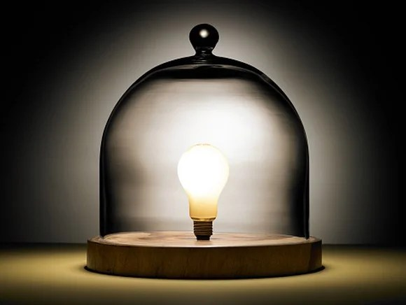 Picture of a bright light bulb under a glass dome.