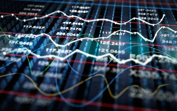 A big board of stock prices and graphs.