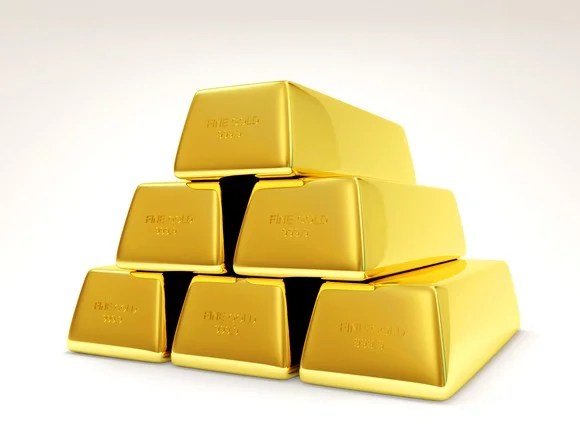 Gold bars stacked into a pyramid shape.