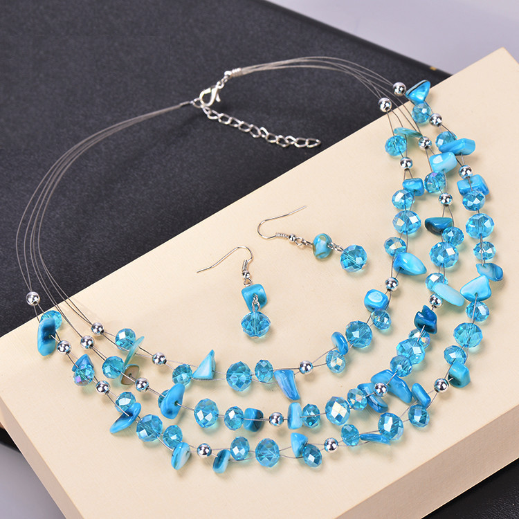 3cfba83c669c Las nuevas mujeres de moda Bohemia Conchas azul blanco cristal perlas  collares de múltiples capas Pendientes multicapa boda Juegos de joyería  (js0044)