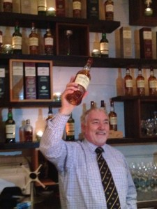 Frank Biskupek holding one of The Glenlivet Scotches we will try.