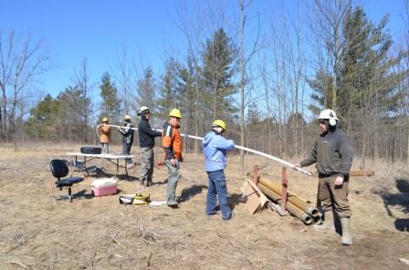 Researchers installing piezometer