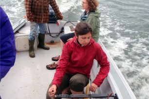 Masters student travelling to the field by boat