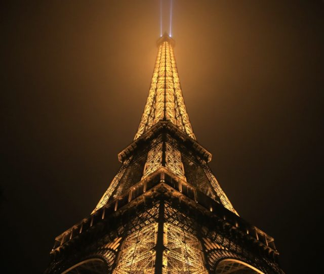 Taking Pictures Of The Eiffel Tower At Night