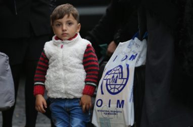 A child from one of the Syrian refugee families arriving at their new homes on the Isle of Bute.