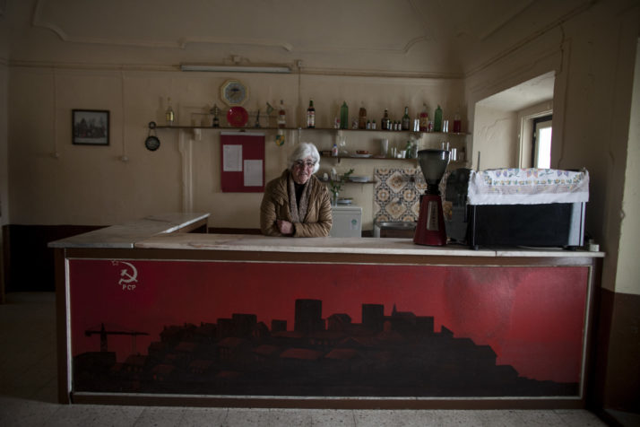 Leonor Xavier behind the counter of the cafe in the Communist Party head office in Avis.