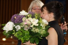 ... is presented with a bouquet by Sabine Sielke as the conference ends.