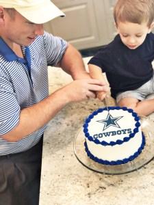 Cutting the Dallas cowboys cake