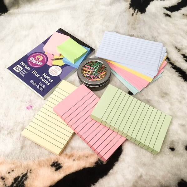 Colored notebooks, index cards, and clips