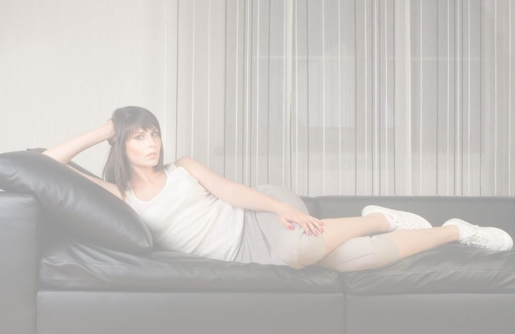 woman exercising on a couch