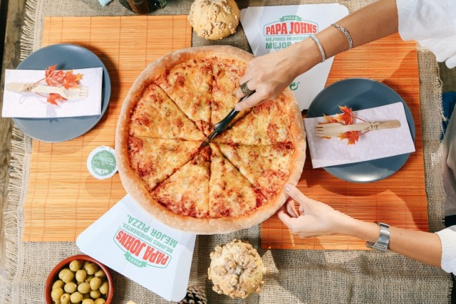 Ración de pizza Papa Jhons Toledo