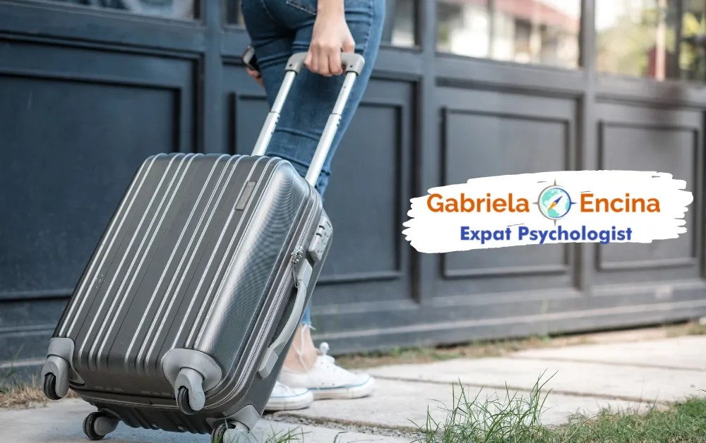 Coping with Expat Guilt in your Life Abroad - Gabriela Encina - Expat Psychologist Online - expat Woman walking with suitcase