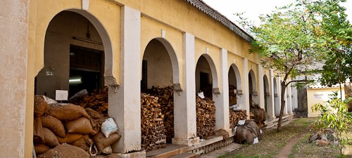 Sandalwood billets and chips stacked ready for processing at the Mysore factory