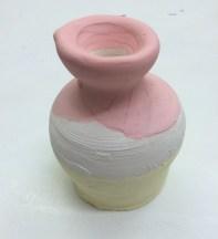 White stoneware with iron pora and iron base, pre-firing (oxidation earthenware). Approx 10cm x 5cm x 5cm.