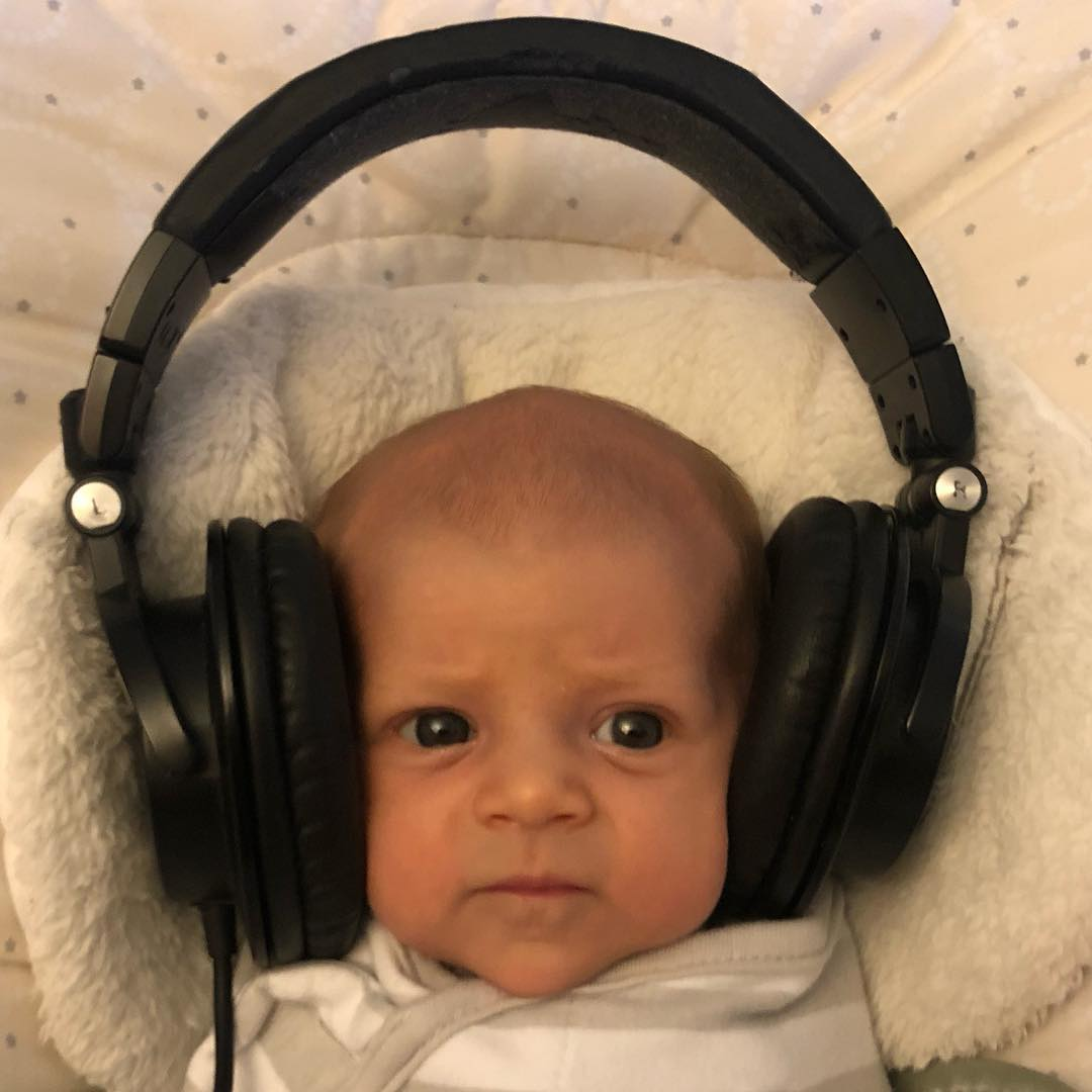 Listening on daddy's headphones :) DJ Iz in the house!