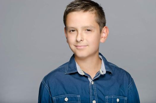 Studio Modeling Headshot of a young boy against a grey backdrop