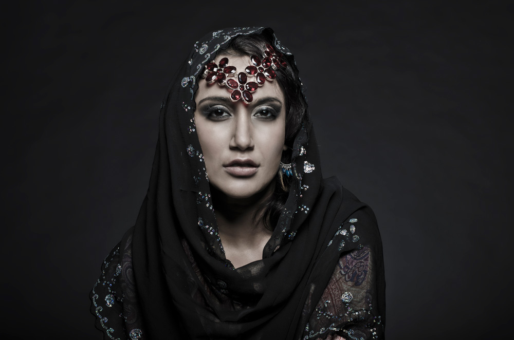Fashion couture modeling portrait of a persian woman in traditional dress