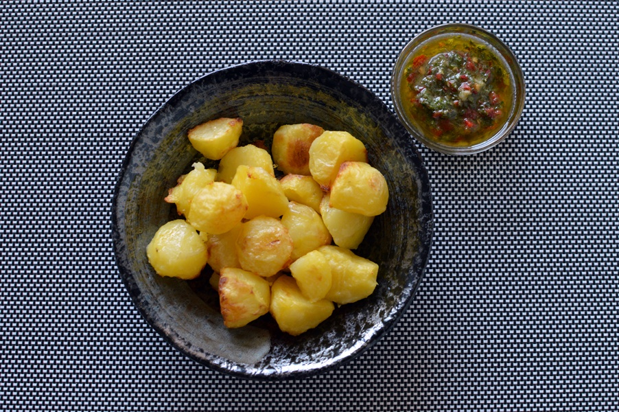 Smashed potatoes with roasted garlic chimichurri