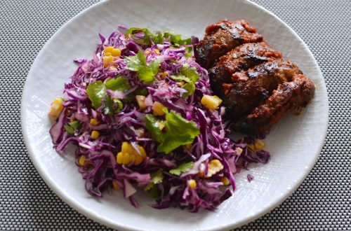Oven-roasted pork ribs with bourbon BBQ sauce and red cabbage slaw
