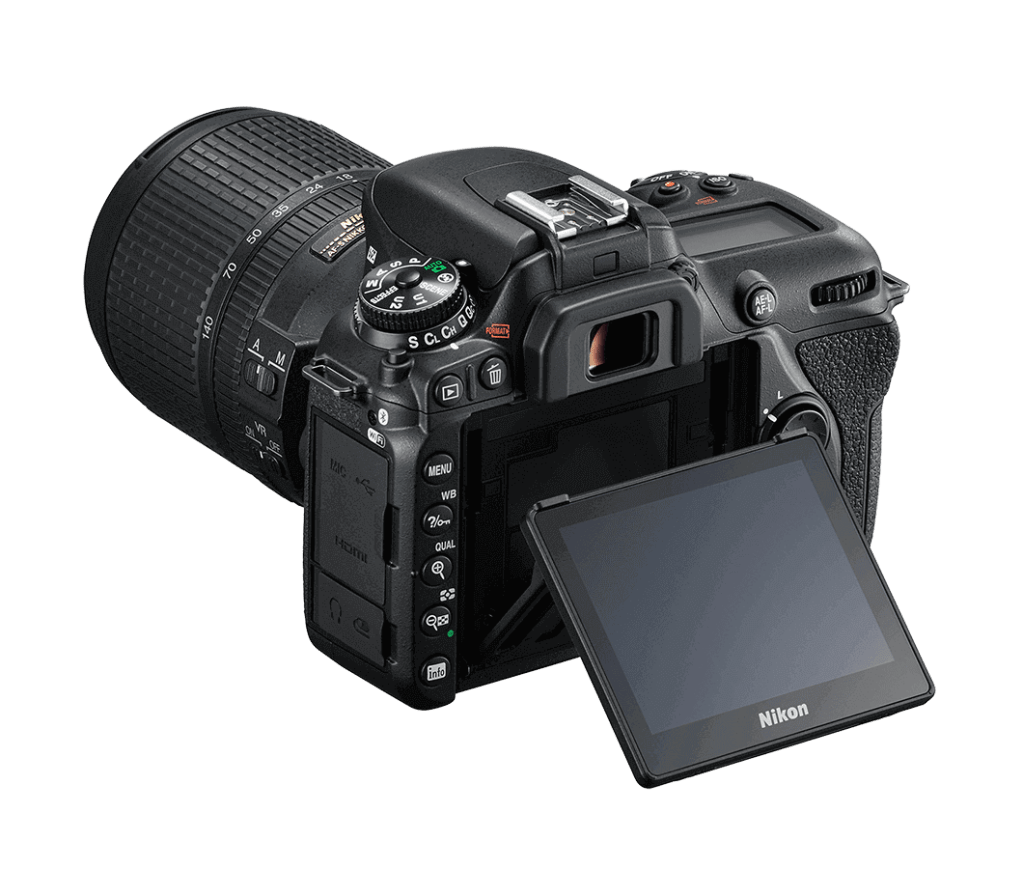 Nikon d7500 Camera with 18-140mm lens in white background.