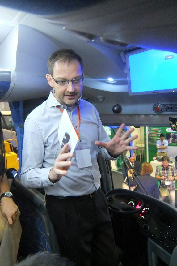 Scania Southeast Asia's Pre-Sales Director Tom Kuiphuis takes the guests through the key features of the coach.