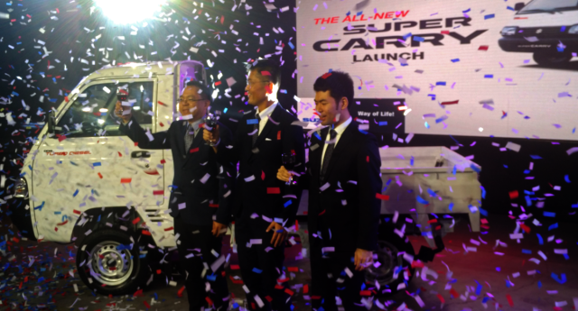 Suzuki Managing Director Norminio Mojica (left) and General Manager for Automobiles Shuzo Hoshikura (center) raise their glass to the newly launched Super Carry