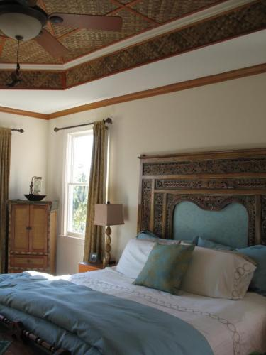 Indonesian Carved Bed Panel as Headboard - Client Photo