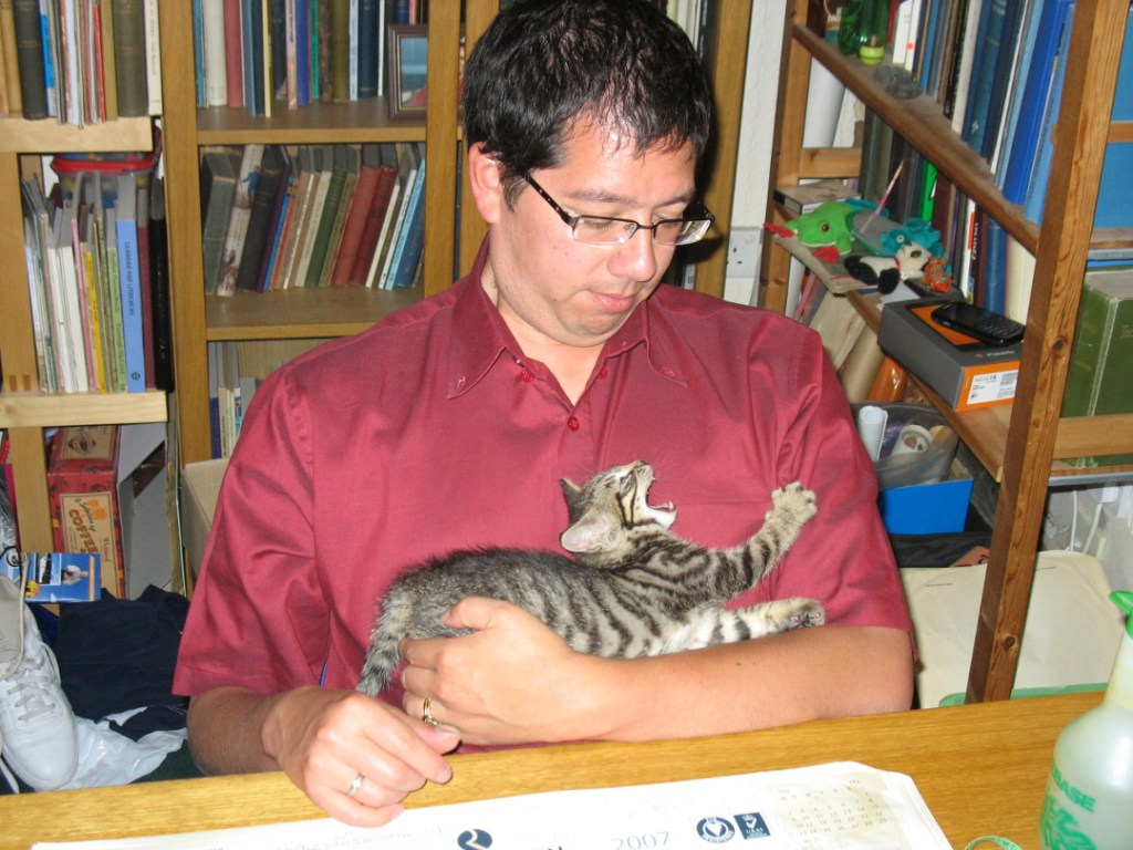 Michael Bauer of Akerbeltz and iGàidhlig with his cat Squiggles