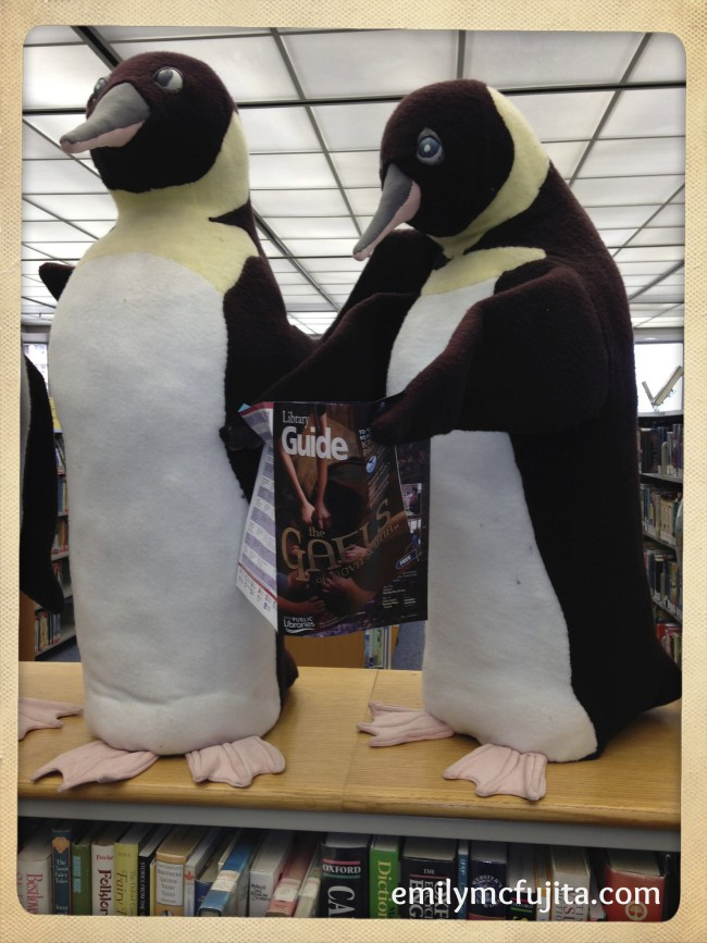 Penguins reading about Gaels in Nova Scotia at Alderney Library