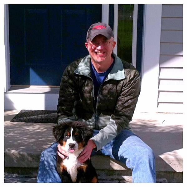 Dr. Andrew Gossen and his new Bernese mountain dog puppy