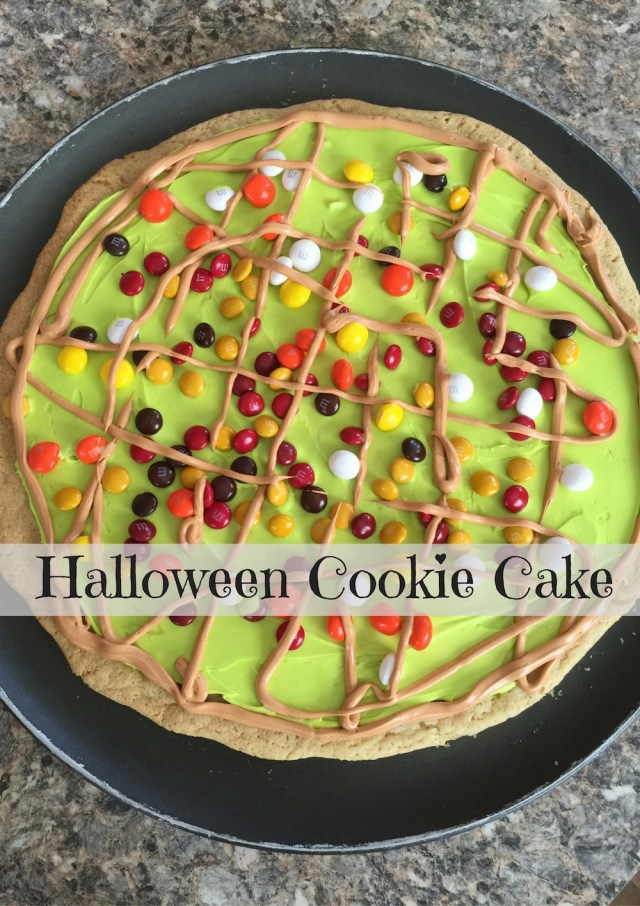 This Hallowe'en Cookie Cake is a great way to use up leftover Hallowe'en candy. Check out the rest of the #12DaysOf Hallowe'en @ GagenGirls.com for more crafts and recipes.