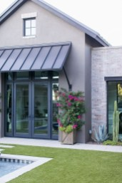 Incredible Farmhouse Exterior Ideas With Metal Roof 12
