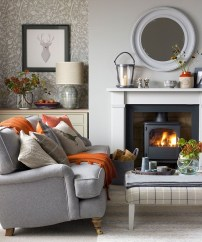 Delicate Living Room Design Ideas With Fireplace To Keep You Warm This Winter 21
