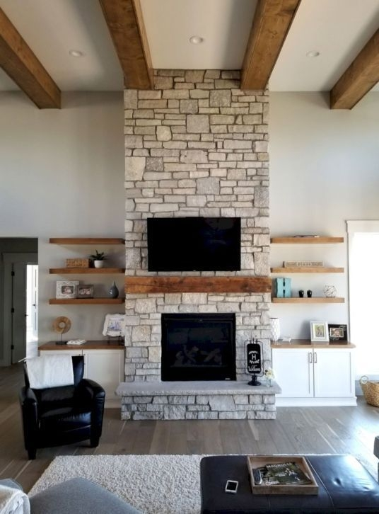 Delicate Living Room Design Ideas With Fireplace To Keep You Warm This Winter 32