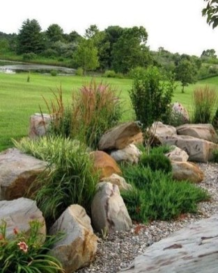 Delicate Garden Landscaping Design Ideas Using Rocks Stone To Try 16