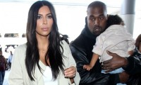Kim Kardashian, Kanye West and their daughter North en route to Armenia. Photograph: Broadimage/Rex