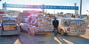 Pickup trucks loaded with fertilizer and ammonium nitrate, which is widely used in agriculture but also for building explosives, head to Tel Abyad. (Photo: Cihan)