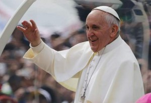 Pope Francis waves from his popemobile in Rio de Janeiro, Brazil, Sunday, July 28, 2013. THE ASSOCIATED PRESS