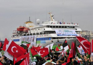 Pro-Palestinian activists wave Turkish and Palestinian flags during the welcoming ceremony for cruise liner Mavi Marmara