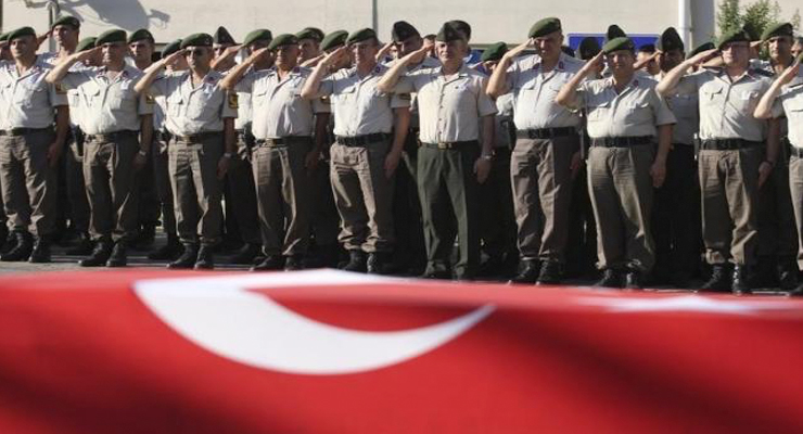 Turkish police officers salute during a funeral ceremony for police officer Nedip Cengiz Eker in Marmaris, Turkey, July 16, 2016. REUTERS/KENAN GURBUZ